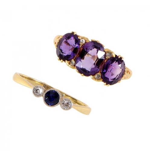 360 - <p>A SAPPHIRE AND DIAMOND THREE STONE RING in gold, marked 18ct & PT and an amethyst and diamond rin...