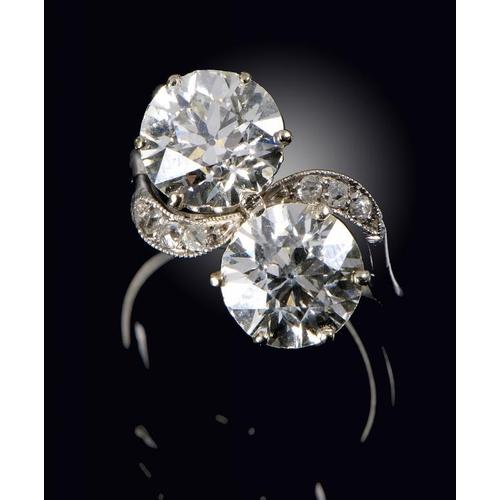 361 - <p>A DIAMOND CROSS-OVER RING  in platinum, size K</p><p></p>...