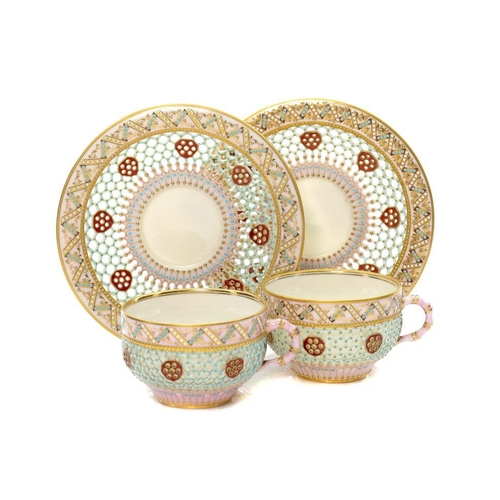 171 - <p>TWO ROYAL WORCESTER HONEYCOMB RETICULATED CABINET CUPS AND SAUCERS, 1877 AND CIRCA the double wal...