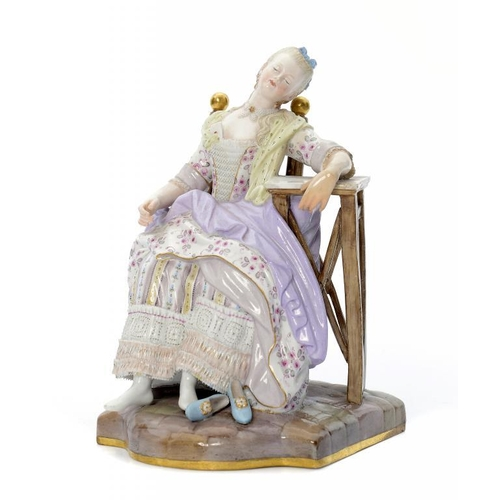 185 - <p>A MEISSEN FIGURE OF A MAIDEN ASLEEP IN A CHAIR, LATE 19TH/EARLY 20TH C in lace trimmed striped go...