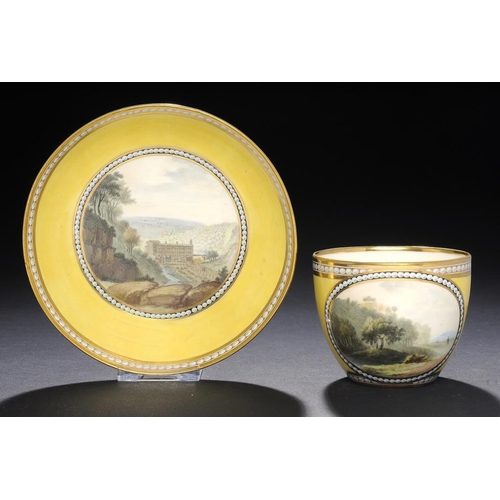 52 - <p>A FINE DERBY CANARY YELLOW GROUND TEACUP AND SAUCER, C1795 painted with a view of Sir Richard Ark...
