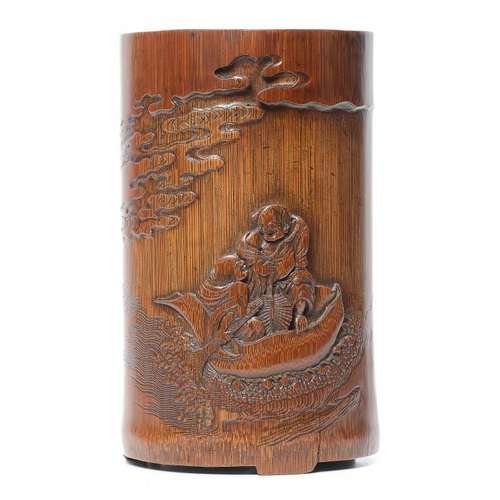 323 - <p>A CHINESE BAMBOO BRUSH POT, QING DYNASTY, 19TH C carved with two figures afloat in a lotus, the r...