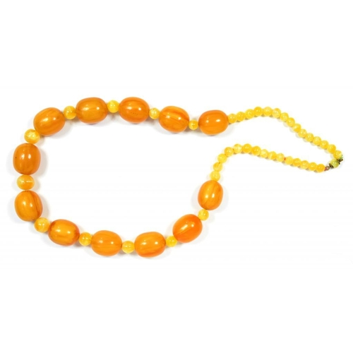 353 - <p>A NECKLACE OF AMBER AND YELLOW GLASS BEADS 154.7G</p><p></p>...
