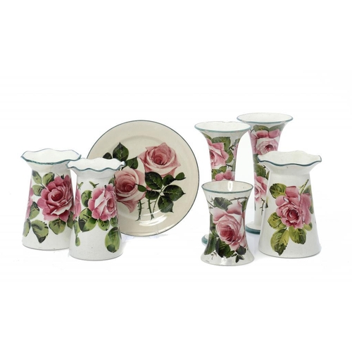 52 - <p>FOUR AND A PAIR OF WEMYSS WARE VASES AND A PLATE, C1900 painted by Karel Nekola (pair of trumpet ...