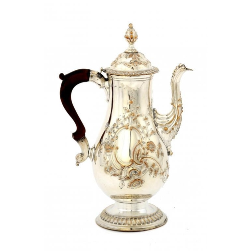 529 - <p>AN EARLY SHEFFIELD PLATE REPOUSS� COFFEE POT AND COVER, C1765    29cm h,  by Tudor & Co</p><p>Ill...