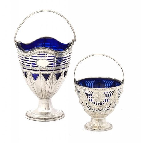 544 - <p>TWO SHEFFIELD PLATE  PIERCED VASE SHAPED SUGAR BASKETS, C1775 with swing handle, blue glass liner...