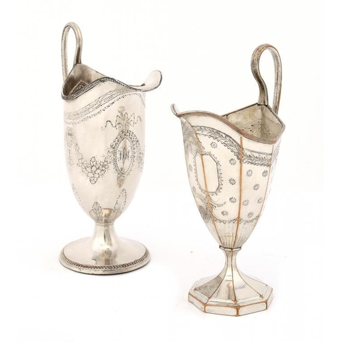 545 - <p>TWO SHEFFIELD PLATE HELMET SHAPED CREAM JUGS, C1785 16cm h</p><p>Illustrated: Crosskey, op cit, f...