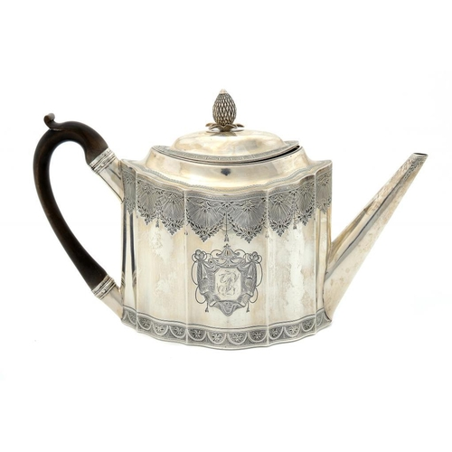 583 - <p>A GEORGE III SILVER TEAPOT  of fluted oval shape and bright cut, the domed lid with integral hing...