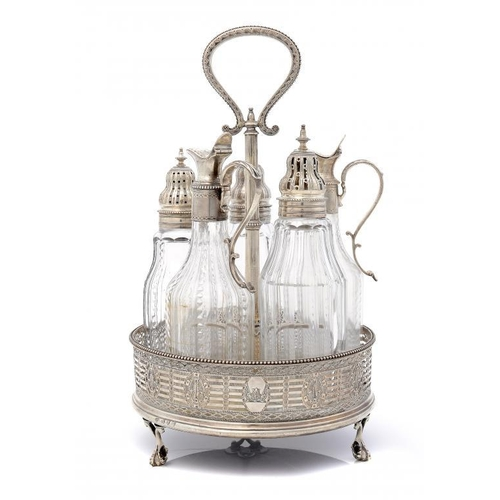 584 - <p>A GEORGE III SILVER CRUET FRAME finely pierced and engraved, with beaded handle and claw-and-ball...