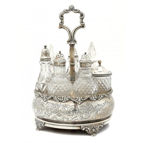 588 - <p>A VICTORIAN SILVER CRUET  of bomb� form with seven cut glass condiment bottles with lid, cover or...
