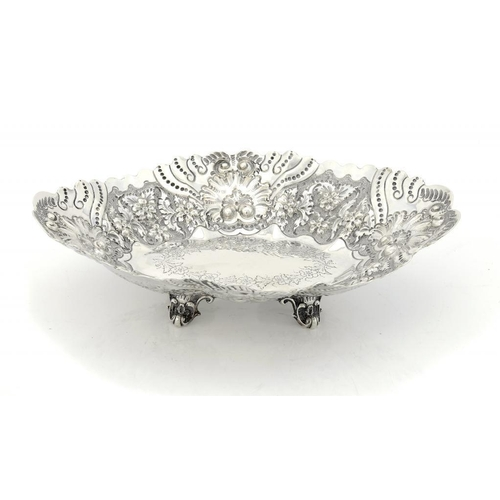 599 - <p>A VICTORIAN LOBED AND EMBOSSED SILVER FRUIT DISH  on four feet, 22.5cm w, by Martin, Hall & Co Lt...