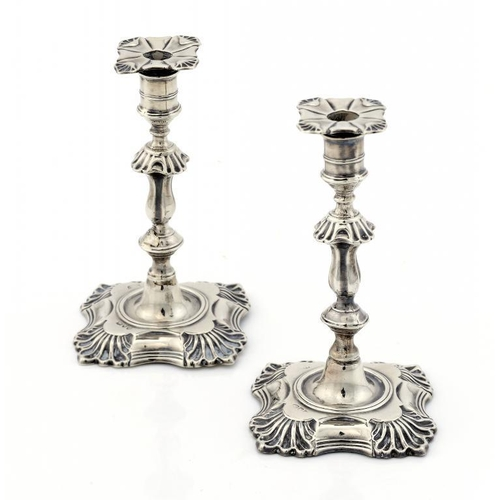 601 - <p>A PAIR OF VICTORIAN SILVER TAPERSTICKS with nozzles, 12cm h, by Hawksworth, Eyre & Co Ltd, London...