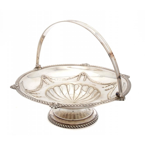 602 - <p>A VICTORIAN SILVER CAKE BASKET   with swing handle, 27cm w, by W Hutton & Sons Ltd, London 1899, ...