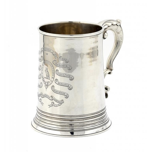 615 - <p>A GEORGE III SILVER MUG  with leaf capped handle, engraved with  crest and inscribed with teh nam...