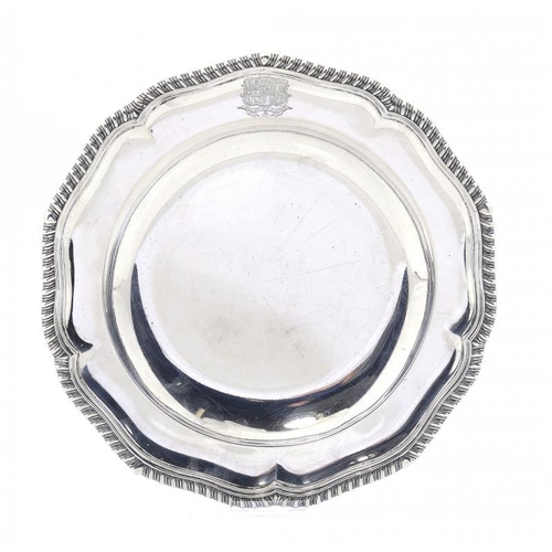 616 - <p>A WILLIAM IV SILVER GADROONED PLATE  engraved with armorials, 25cm diam, by Waterhouse & Son, Bir...