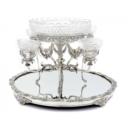 625 - <p>A GEORGE III SILVER EPERGNE AND A SCOTTISH  VICTORIAN SILVER MIRROR PLATEAU the oval epergne on f...