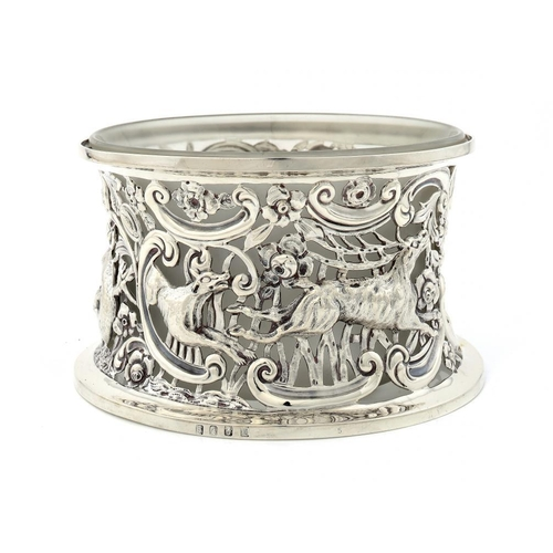 626 - <p>AN IRISH VICTORIAN SILVER POTATO RING chased  in high relief   with animals from the chase,  20.5...