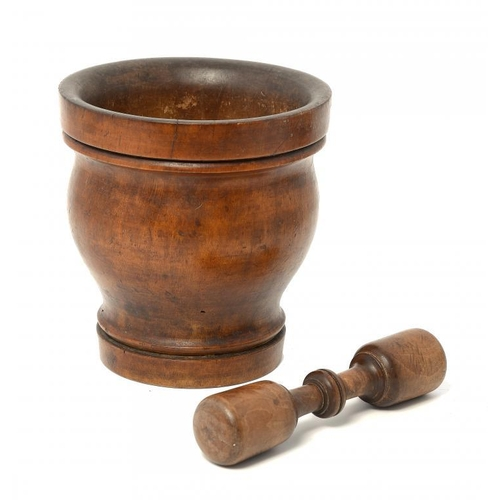 945 - <p>TREEN.  A TURNED WOOD PESTLE AND MORTAR, PROBABLY FRENCH, 19TH C  mortar 19cm h</p><p></p>...
