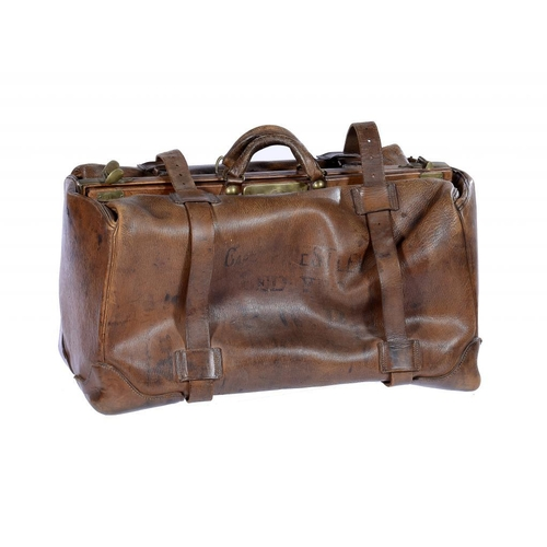 952 - <p>A VINTAGE LEATHER KIT BAG, EARLY 20TH C  with brass mounts and lock marked SECURE LEVER, leather ...