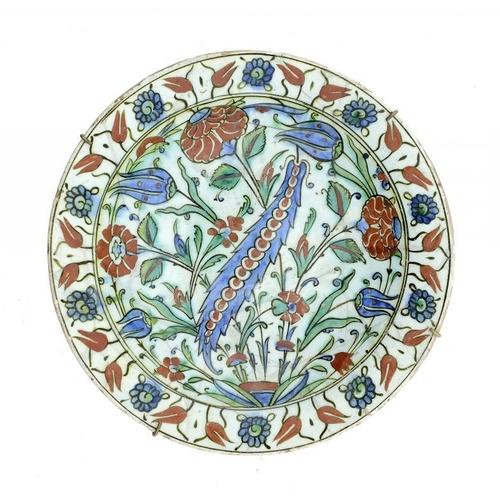966 - <p>AN IZNIK DISH, 17TH C  painted with a saz leaf and tulips, 30cm diam</p><p></p>...
