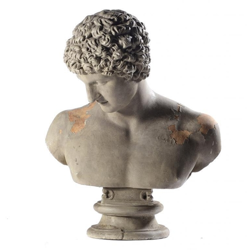 972 - <p>A  REGENCY  'GRAND TOUR' PAINTED PLASTER BUST OF ANTINOUS AFTER THE ANTIQUE, EARLY 19TH C  66cm h...