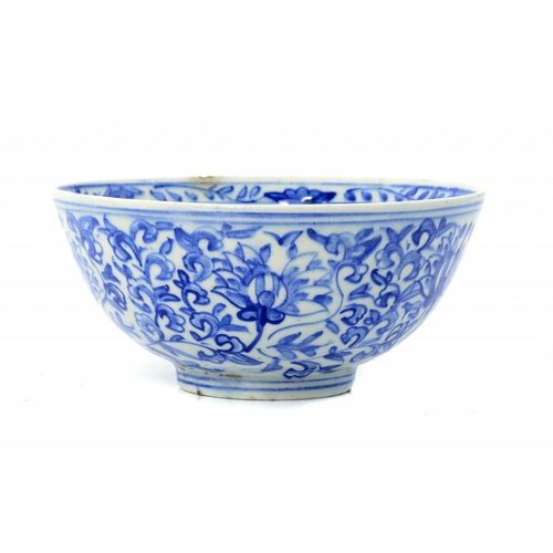 975 - <p>A PERSIAN BLUE AND WHITE FRIT WARE BOWL, 18TH C  painted in Ming style with flowers, 16.5cm diam<...