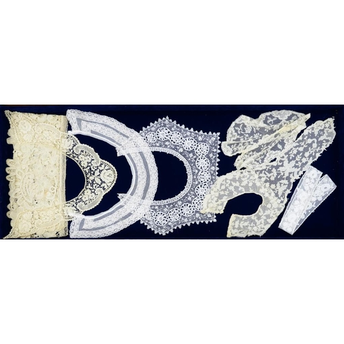 992 - <p>A QUANTITY OF 19TH AND EARLY 20TH C LACE DECORATED GARMENTS including three collars, a cravat, ni...