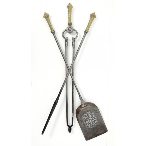 994 - <p>A SET OF THREE VICTORIAN BRASS HANDLED BURNISHED STEEL FIRE IRONS  73 and 77cm l</p><p></p>...