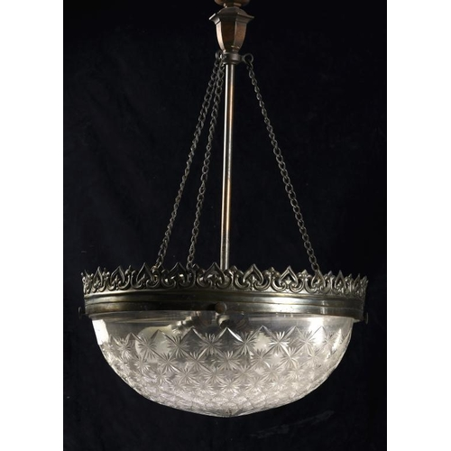997 - <p>AN OXIDISED BRASS AND CUT GLASS ELECTRIC CEILING LIGHT, C1920/30  the hemispherical bowl 40cm dia...