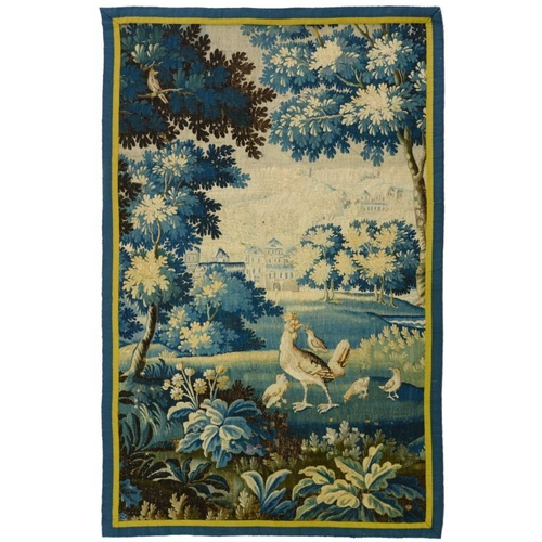 923 - <p>A FLEMISH VERDURE TAPESTRY FRAGMENT, LATE 17TH C  185 x 110cm including later border</p><p></p>...