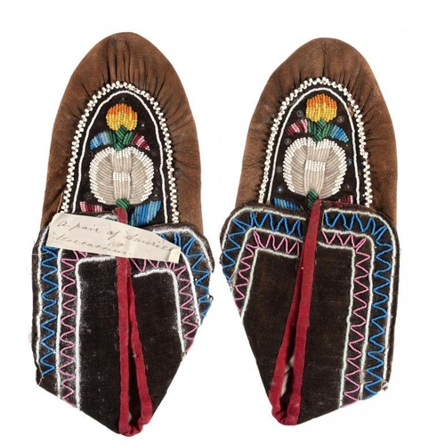 12 - <p>A PAIR OF NATIVE AMERICAN LEATHER, FABRIC AND BEADWORK MOCCASINS, LATE 19TH C approximately 24cm ...