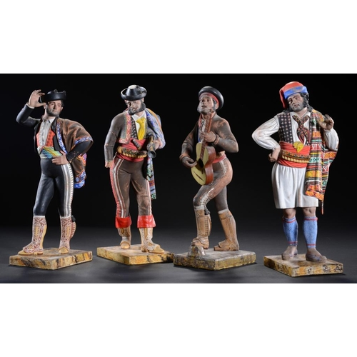 13 - <p>A SET OF FOUR SPANISH COLD PAINTED TERRACOTTA FIGURES ON PAINTED WOOD FAUX MARBLE BASES, C1870  3...