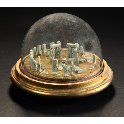 15 - <p>A VICTORIAN PALE GREEN PAINTED PLASTER OR COMPOSITION MODEL OF STONEHENGE  on turned giltwood bas...