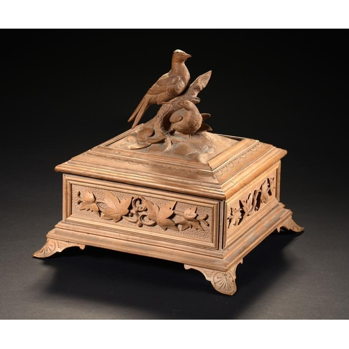 16 - <p>A SWISS LIMEWOOD JEWEL BOX, LATE 19TH C  the lid carved in the round with two birds, the sides wi...