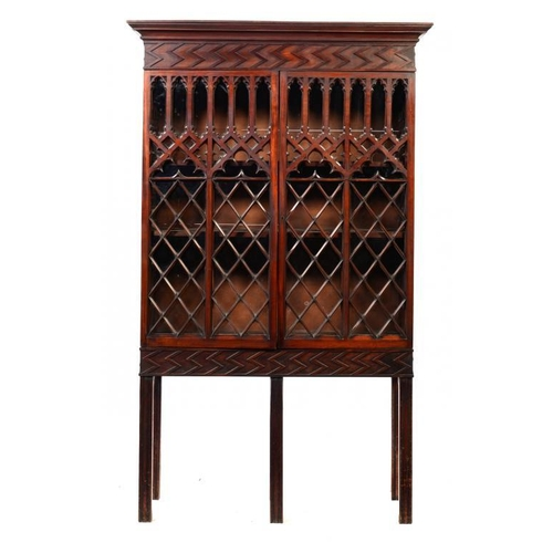 194 - A GEORGE IV GOTHIC MAHOGANY BOOKCASE, C1830  with adjustable shelves, on moulded legs, 205cm h; 39 x...