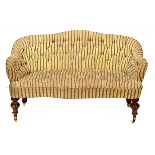195 - A VICTORIAN WALNUT SOFA, C1860  of serpentine form in buttoned upholstery, on turned forelegs with p...