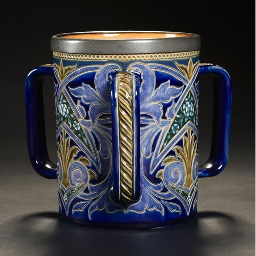 1 - <p>A DOULTON WARE PATE SUR PATE LOVING CUP, C1890 decorated by Emily E Stormer with panels of flower...