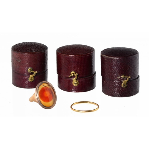 31 - <p>A CORNELIAN RING, EARLY 19TH C in gold, size F, a gold wedding ring and three mid 19th c maroon l...