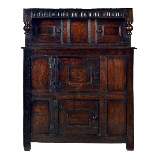 1095 - <p>AN ENGLISH OR WELSH OAK LIVERY CUPBOARD, C1700  with nulled frieze and bulbous pendants, the four...