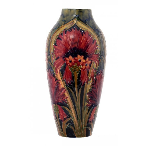 14 - <p>A MOORCROFT CORNFLOWER VASE, DATED 1915  32cm h, impressed marks, green painted signature and dat...