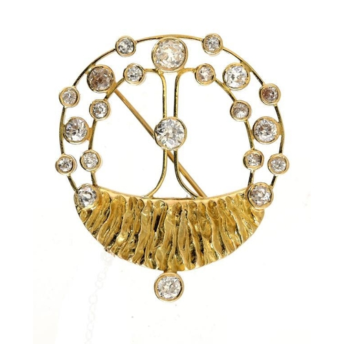 372 - <p>A DIAMOND BROOCH, 1983 with diamond collets of varying size in 18ct textured and openwork gold, m...