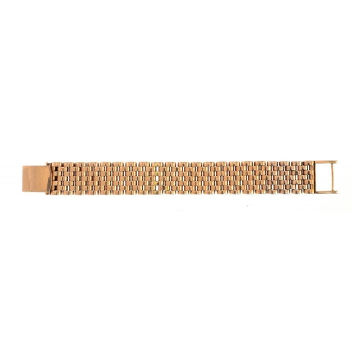 376 - <p>A GOLD BRACELET, MID 20TH C  marked on clasp UNIVERSAL GENEVE 750, 47.5g</p><p></p>...