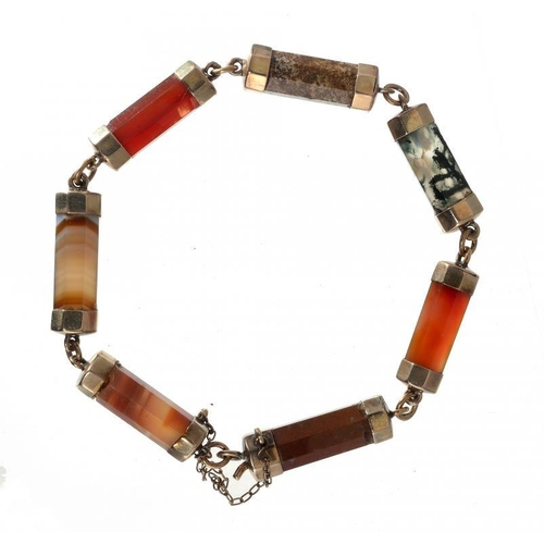 379 - <p>A VICTORIAN GOLD AND HARDSTONE BRACELET, PROBABLY SCOTTISH, LATE 19TH C  composed of seven hexago...