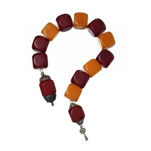 436 - <p>A MIDDLE EASTERN SILVER COLOURED METAL MOUNTED NECKLACE OF FIVE AMBER COLOURED AND EIGHT CHERRY C...