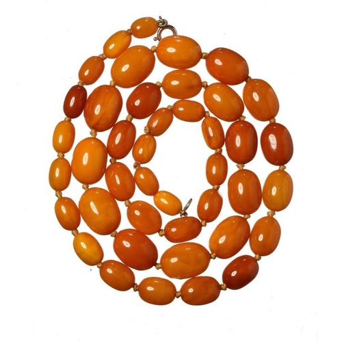 444 - <p>A NECKLACE OF 42 AMBER BEADS  46g</p>...