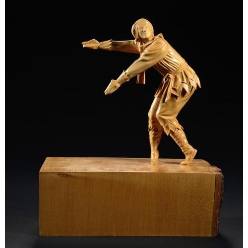 788 - GORDON C BROWN (2OTH/21ST CENTURY) PETRUSHKA    limewood, 34cm hThe sculpture was based on Peter Sch...