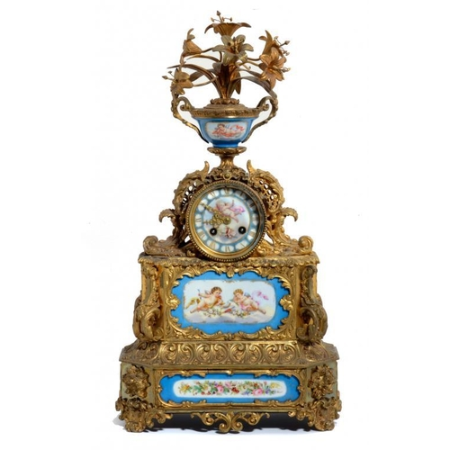 794 - A FRENCH GILT BRASS MANTLE CLOCK INSET WITH S�VRES STYLE PORCELAIN PLAQUES, C1880 the drum cased mov...