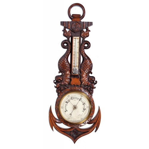 797A - A VICTORIAN CARVED OAK 'NAUTICAL' ANEROID BAROMETER, C1900 in the form of an anchor and dolphins, th...