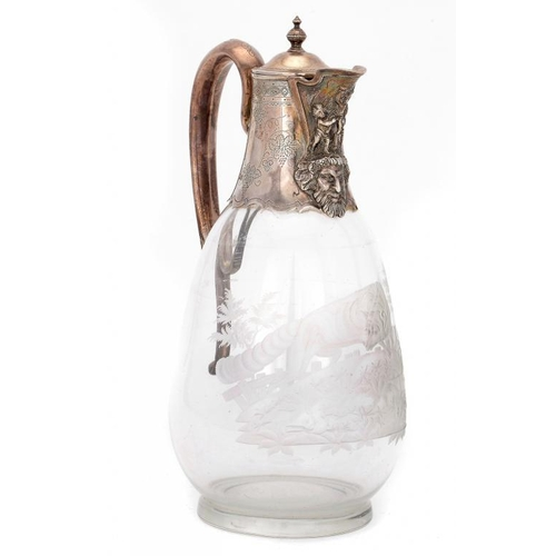 513 - A VICTORIAN SILVER MOUNTED GLASS CLARET JUG   with  mask lip, the body engraved with a fox, 24.5cm h...