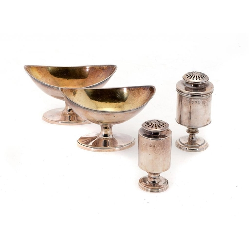 521 - TWO GEORGE III CYLINDRICAL SILVER PEPPER CASTERS AND COVERS 7.5 & 8.5cm h, marked on side and cover,...
